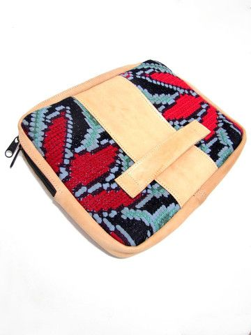 Handcrafted clutch combining local goatskin leather with a cross ...