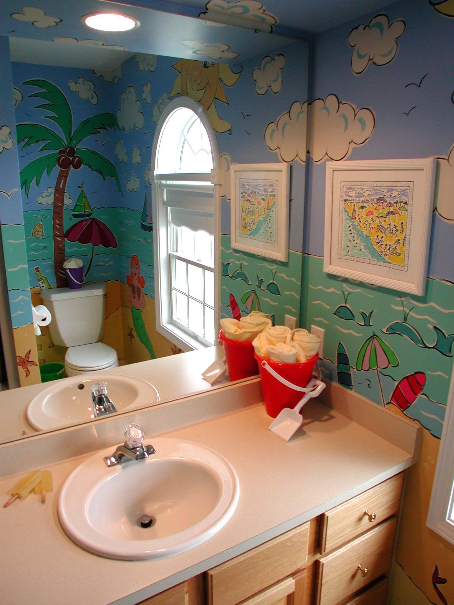 Beach themed mural in a kids bathroom Sky Surf and sand