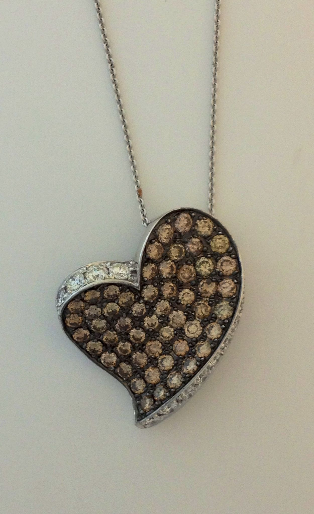 Floating Heart shaped Pendent decorated with 1.5 carats of Dazzling Coffee Colored Diamonds. Available at Anaheim Hills Jewelry & Coin.