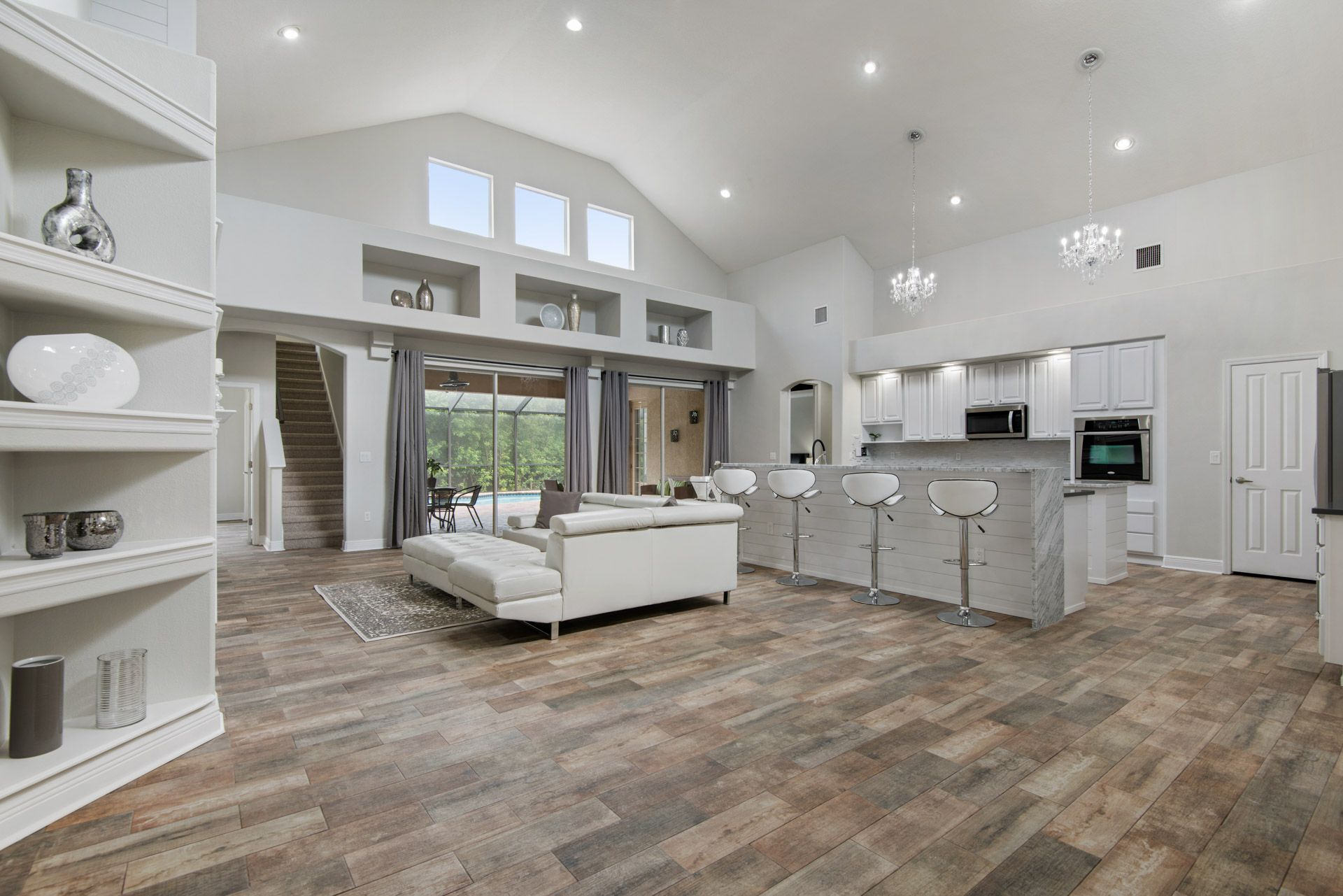 Open Floor Plan With A Large White Modern Kitchen White Modern Kitchen Home Selling Tips Home Buying