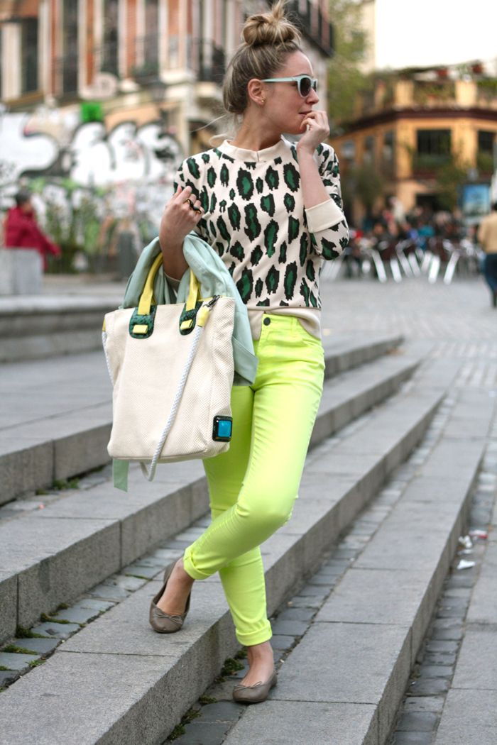 animal print top, neon yellow pants, and sky blue trench coat