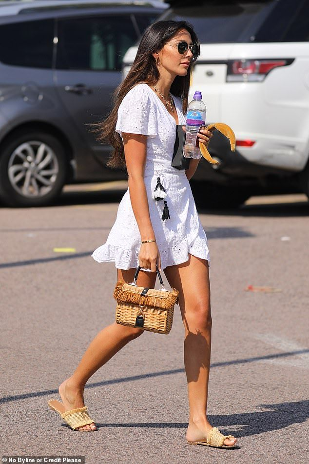 Michelle Keegan flaunts her pins in a cool white summer dress