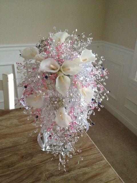 Cascading Clear & Pink Crystal bouquet with silk flower accents! www.crystalbloomweddings.com Follow us on Instagram: @crystalbloomweddings