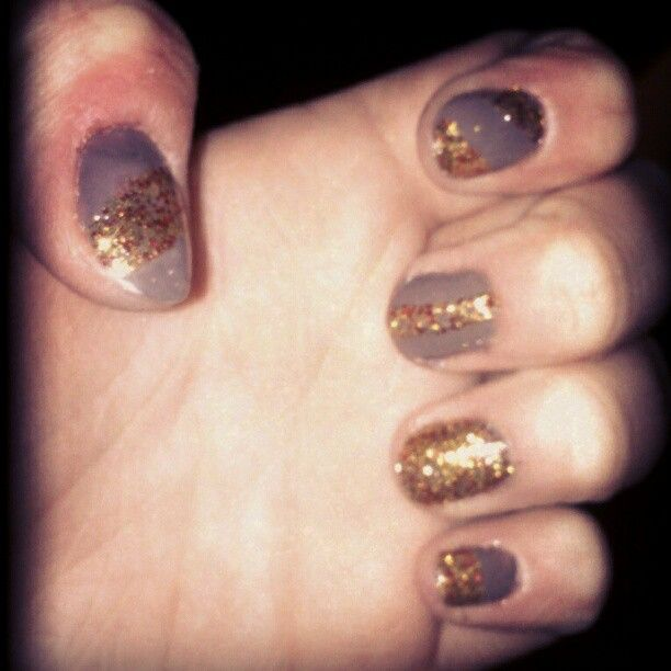 """My nails. That I did, myself. Yeah, they're fierce. You can be jealous. Revlon Quick Dry in Stormy and China Glaze's """"Electrify"""" from the Colours from the Capitol series."""