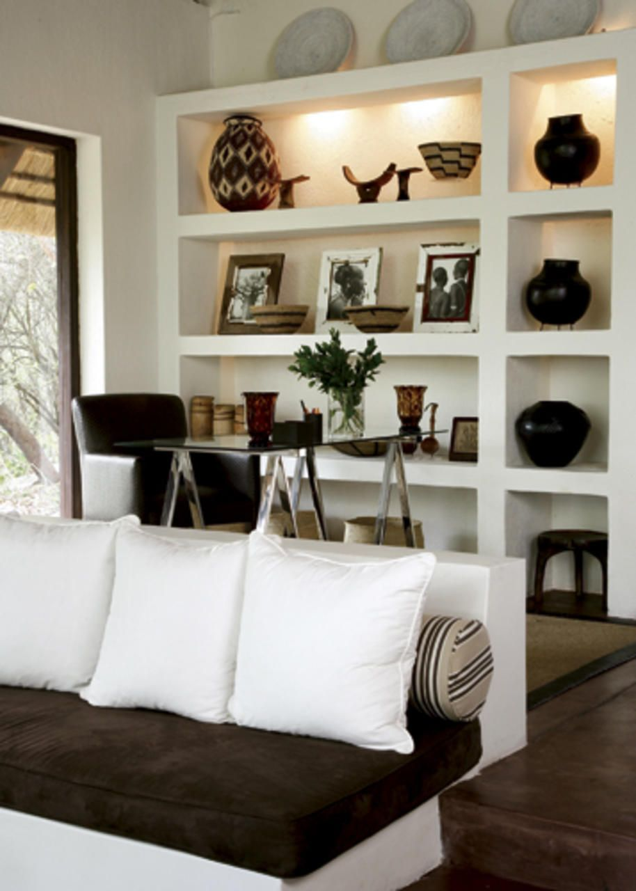 Afrocentric Style Decor - Design centered on African Influenced Elements -  bookshelf