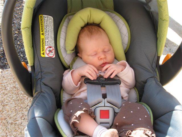 Margaux 2 Months asleep in her car seat