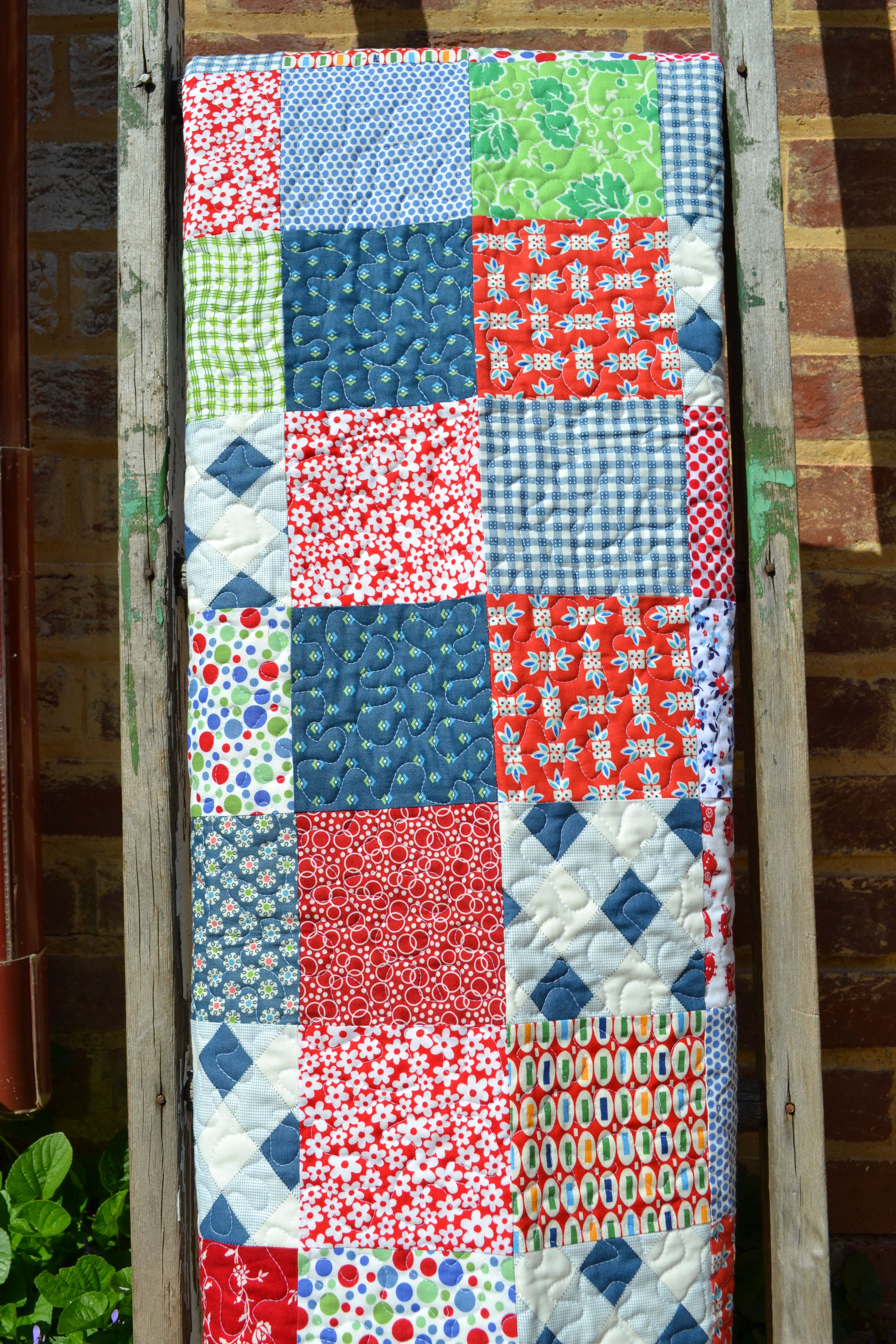 Red, blue and green baby quilt