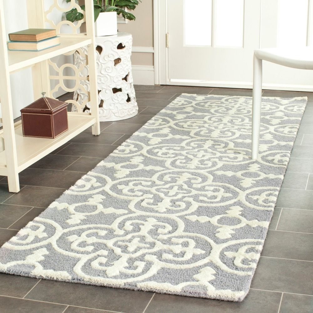 Hallway rug ideas  This contemporary handtufted wool rug with highlow pile is perfect