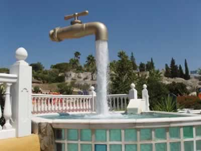 "The ""Magic tap"" (found in ""Aqualand"" of Cadiz, Spain), which appears to float in the sky with an endless supply of water. Actually, there is a pipe hidden in the stream of water that holds the whole structure."