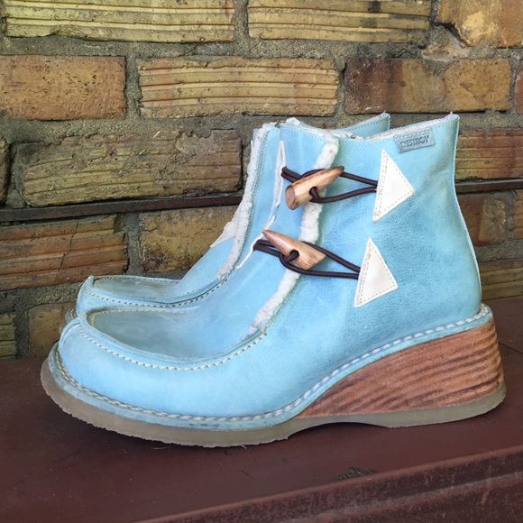 """Baby Blue Leather Moc toe lift boots platforms Purchased in Barcelona Spain! In a tiny little store in """"la ramblas."""" They are so adorable. I bought them for 420€. Which at the time was about $475 here in America. They were for my mom and she hurt her back and now has to wear special shoes. She wore them with everything and is very fashionable. They look so cute with skinnies or leggings! They are scratched up and worn, there are marks and scratches on the toes, sides and inside of leather. I…"""