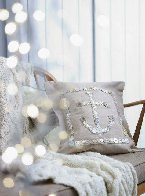 shimmery button anchor pillow on natural linen