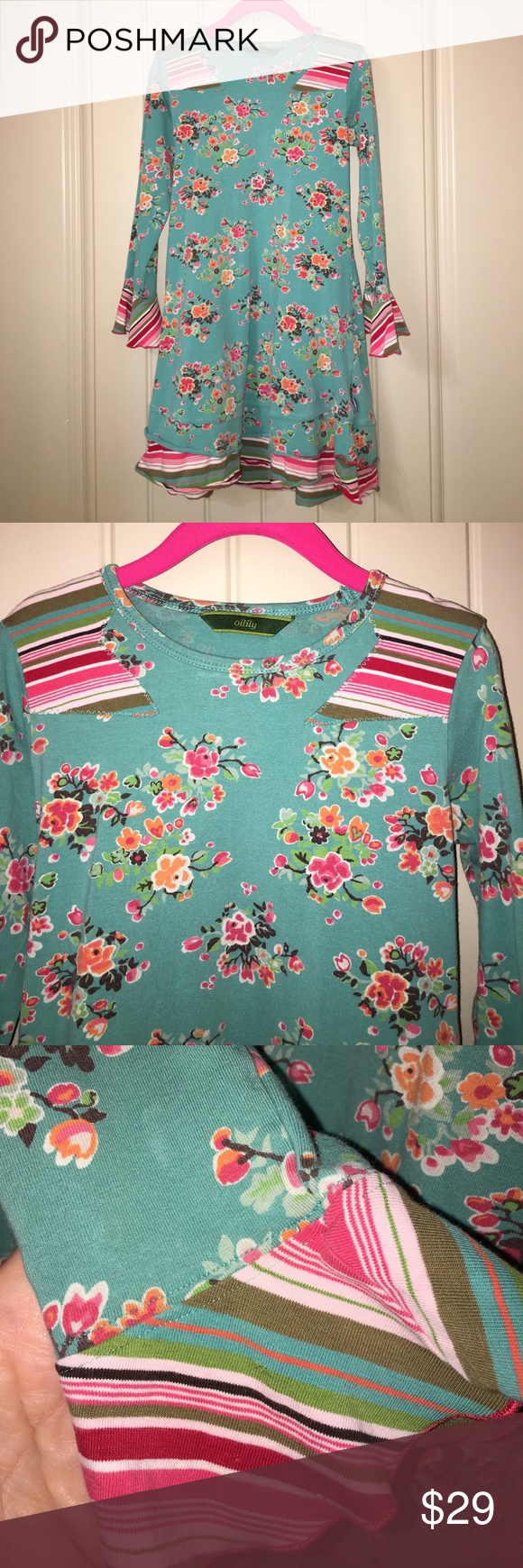 Girls OILILY 116 5/6 yr Euro Aqua School Dress This is a Girls OILILY sz 116 5/6 yr Euro Aqua Blue Floral ruffle School Dress, good used condition, does have a pinhole on sleeve as seen in pic! I ship fast! Happy poshing friends! Oilily Dresses Casual