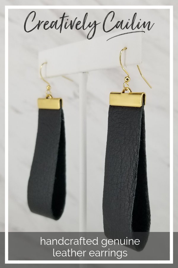 Single drop black leather earrings with gold findings and black ear wire.