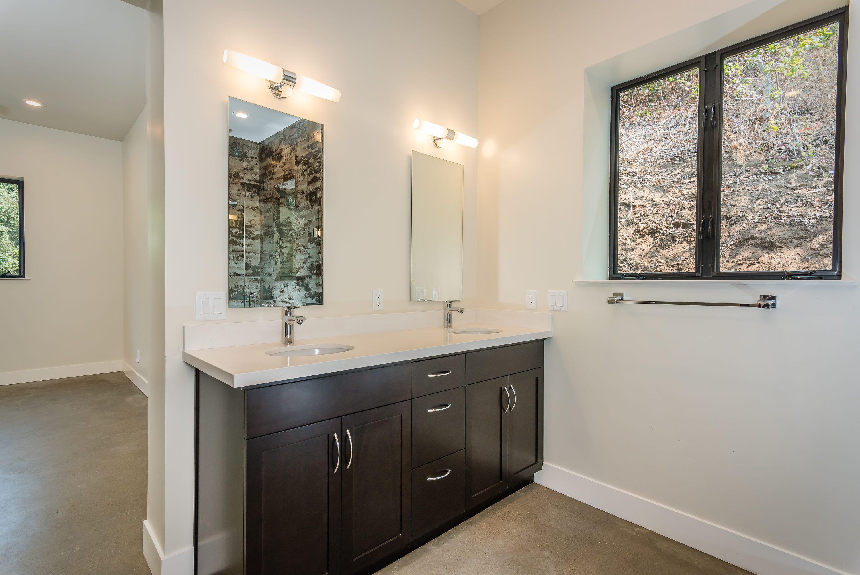 Master Bathroom with Quartz Counter tops / Dark
