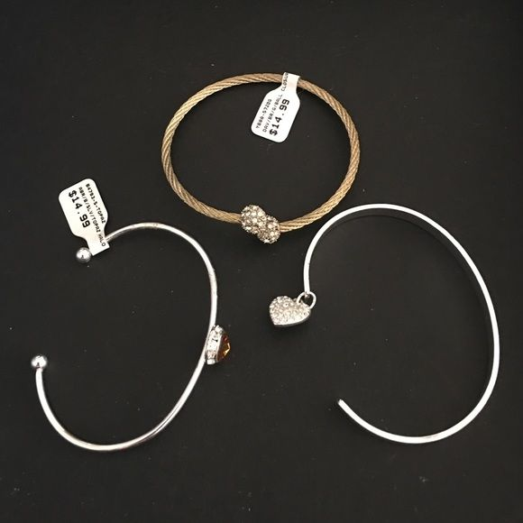 Delicate bangles 💕NWOT Pretty and so delicate bangles - golden with crystal ends ; silver with heart charm and engraving which says follow your heart ; silver with yellow stone and studs- never worn - all will come in separate boxes!! Perfect for gifting ! No trades - Bundles are always welcomed - 15% on 2 items and 20% off on 3 or more items 😊 (all 3 bracelets for $18) Jewelry Bracelets