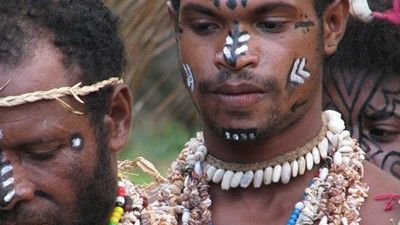 At Peggy Rose's initiation ceremony, two Korafe men in colorful dress attended the ceremony.