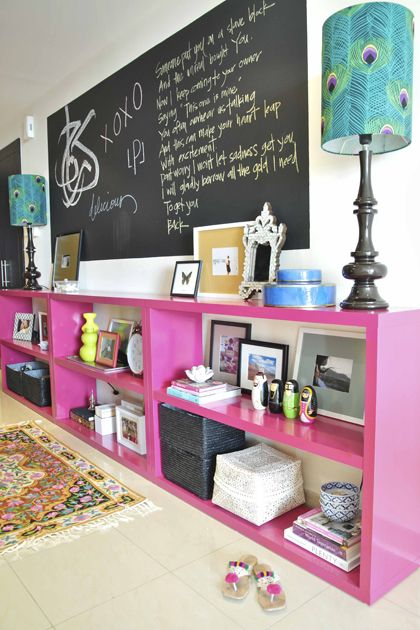 This is SO me. What fun bookshelves and lamps. Loving the chalkboard as well.