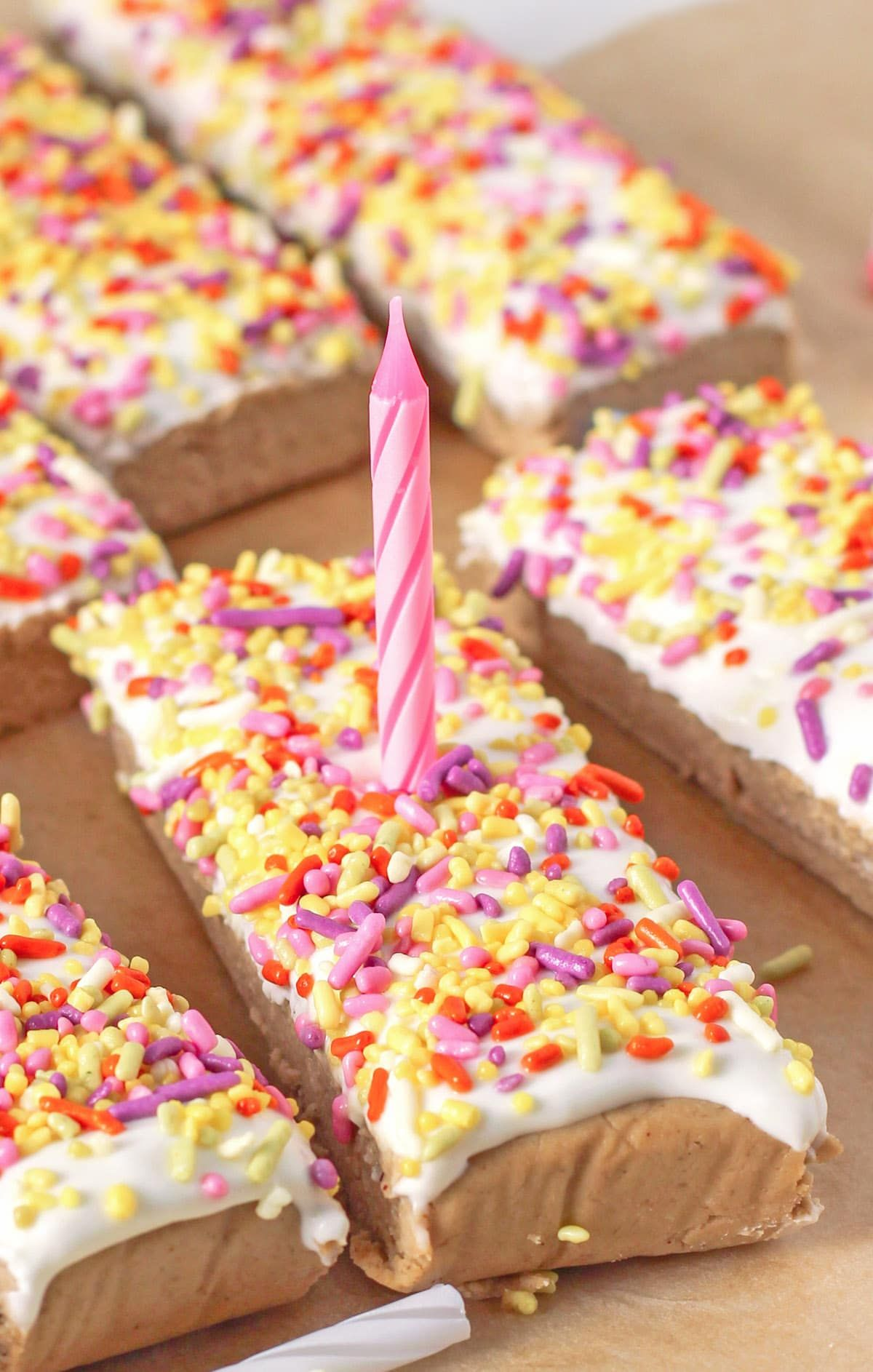 Healthy Birthday Cake Protein Bars with Cream Cheese Frosting and Rainbow Sprinkles