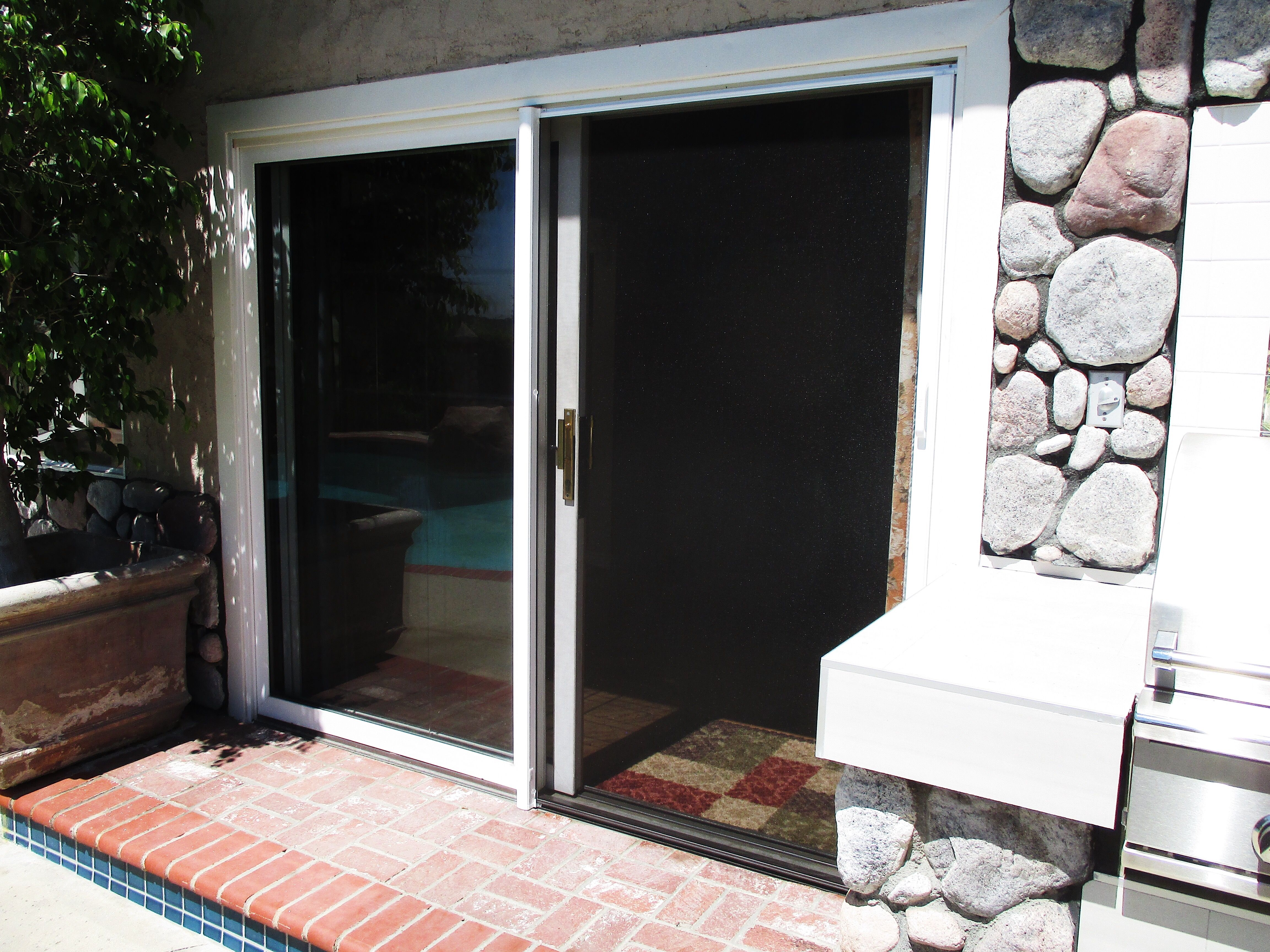 Check Out This White Framed Stowaway Retractable Screen Door With