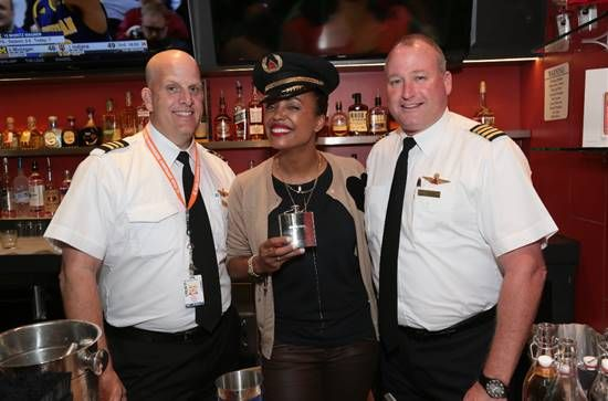 Aisha Tyler - And then I got these lovely @delta pros behind the bar (they had water). That hat weighs seventeen pounds.