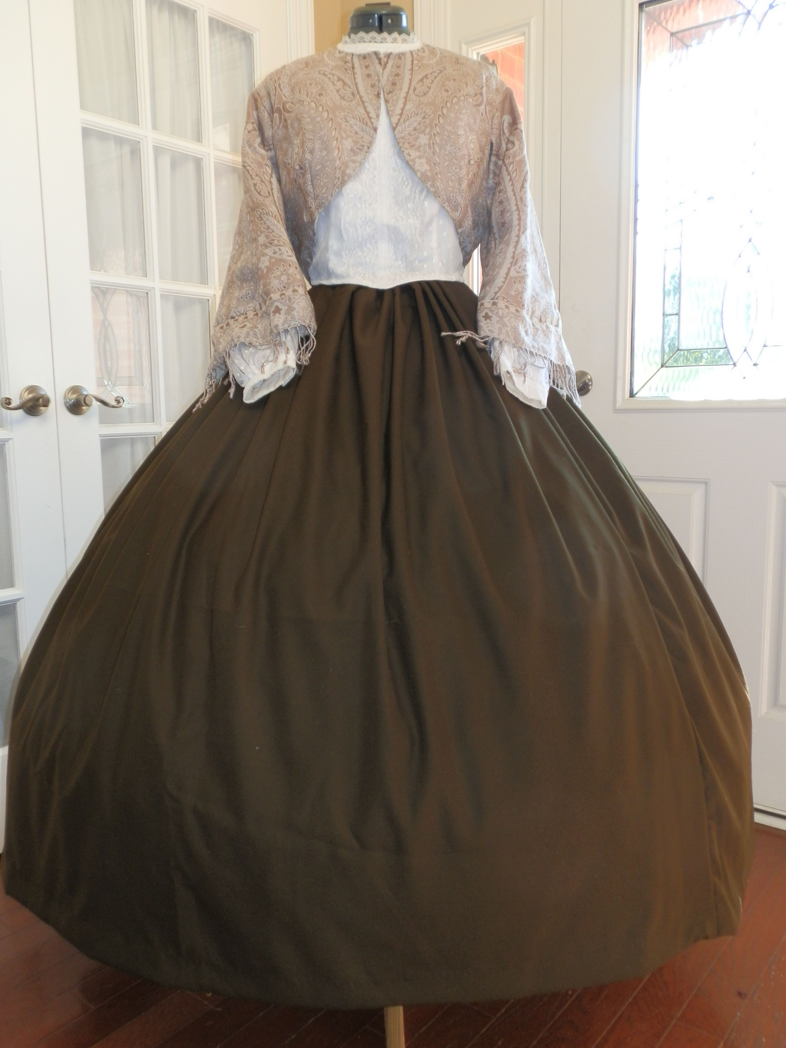 This civil war era zouave and skirt the dark brown skirt is made of