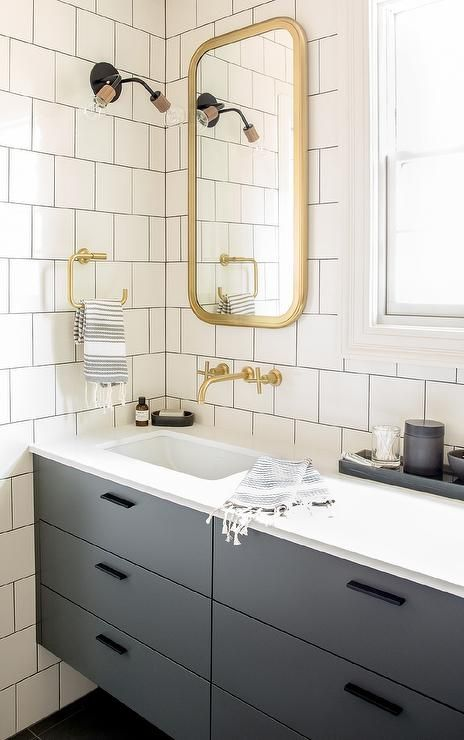Chic Gray And Gold Bathroom Features Walls Clad In White Square Brick Tiles Accented With Dark BathroomMirror