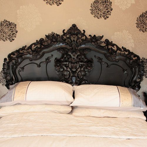Love this French style headboard & the way the wall is