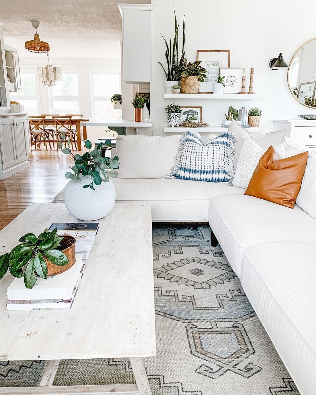 @the.beautyrevival's stunning living room! She's filled her bright area with gorgeous plants and accent pieces, well done 🤩🤩! Click the image to try our free home design app.  (Keywords: living room decor, living room ideas, living room designs, dream rooms, house design, home decor ideas, living room rugs, living room furniture, positive vibes, positive thoughts, boho living room)