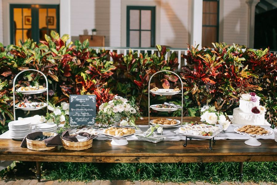 Desserts table. LVL Weddings & Events/Photography: Brandon Kidd Photography/Venue: Olowalu Plantation House/Floral: Wild Heart Floral Design/Catering: Cafe O'Lei/Bartender: Garnish Cocktails/Beauty: 10.11 Makeup/Rentals: Pacific Isle Rentals, Winters Events, Set, and Signature Maui/Stationary: Miss B Calligraphy/Entertainment: Kevin Miso/Cinematography: Sunlit Films/Cake: Maui Sweet Cakes/Transportation: Hawaii Executive Transportation/Accomodations & Rehearsal Dinner: Westin Maui Resort…
