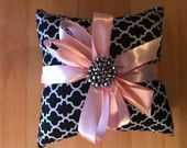 Black, white and pink ring pillow