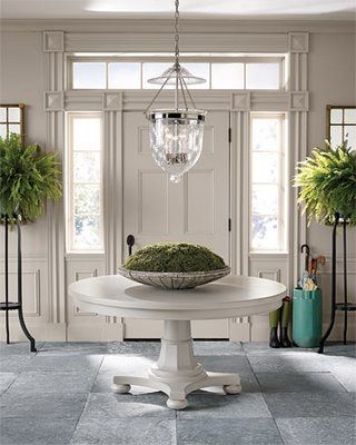 I Love The Plants My Foyer Has A Great Deal Of Light So This Is Simple White With Green Foliage Nice Round Entry Table Round Foyer Table Entry Table Decor