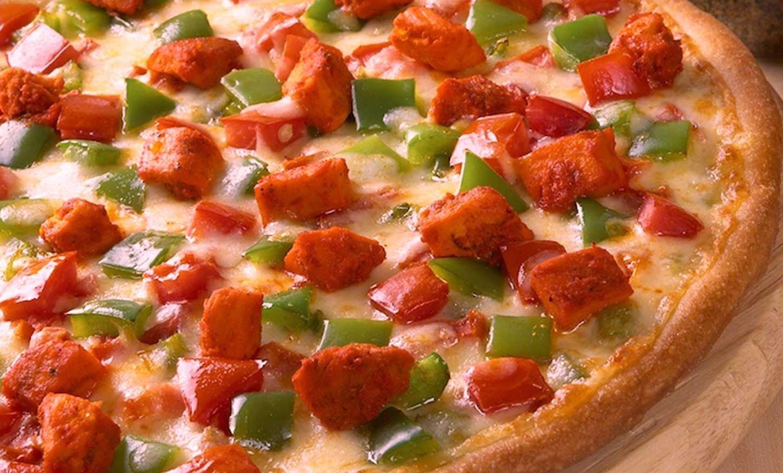 Have a bite of this succulent pizza at Garden Café. # ...