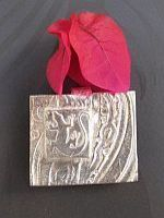 http://www.aromapendants.com.au/products/003-14.jpg. Made by Julie Primmer