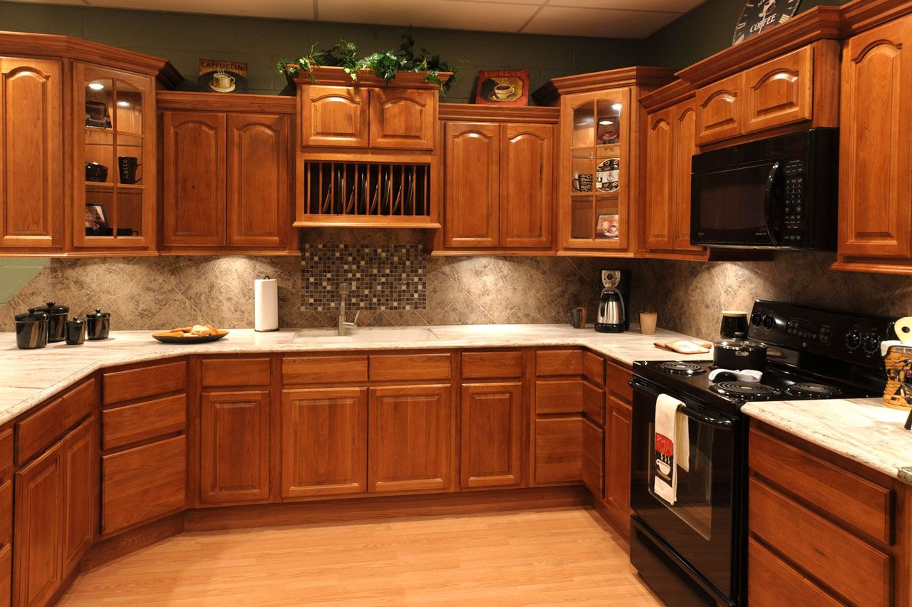 Küchendesign orange farbe oak kitchen cabinets with granite countertops and black appliances