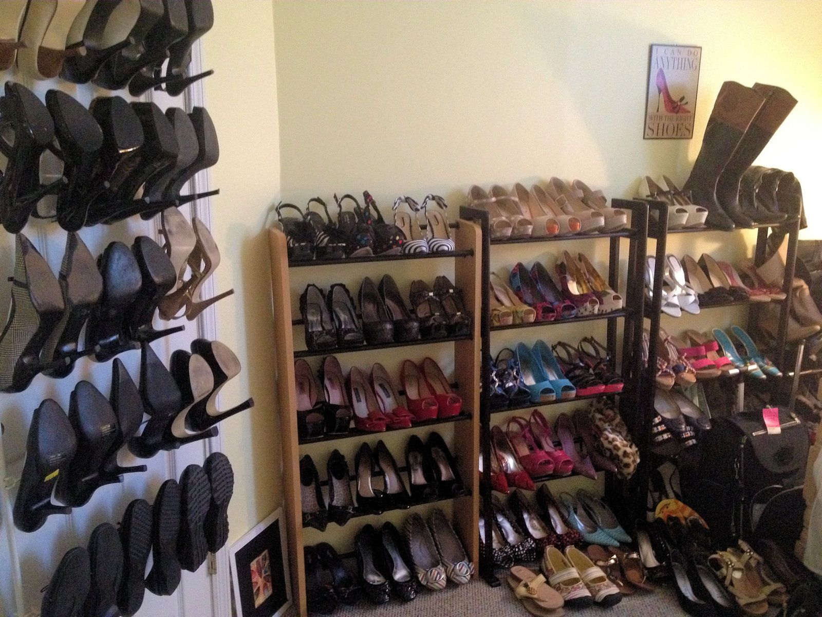 "for @April Thomason ~ my ""shoe wall"" in my dressing room...thrift store CD racks and the obligatory over-the-door shoe rack"