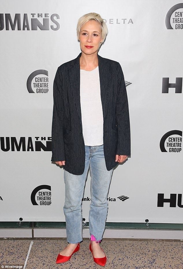 Casual: Gilmore Girls star Liza Weil kept it causal in a dark tailored jacket over a white...
