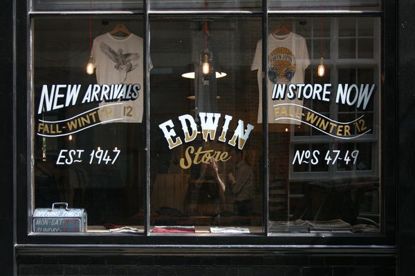 Image result for painted glass storefront sign