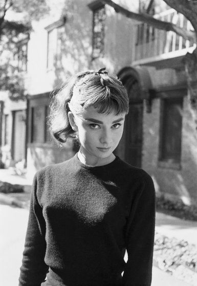 <b>Caption from similar frame in LIFE.</b> For her new movie, Paramount's <i>Sabrina Fair,</i> Audrey stands ready in make-up and costume to play the title role. Acting the daughter of a chauffer for a Long Island family, she is courted alternately by his rich employer's two sons.