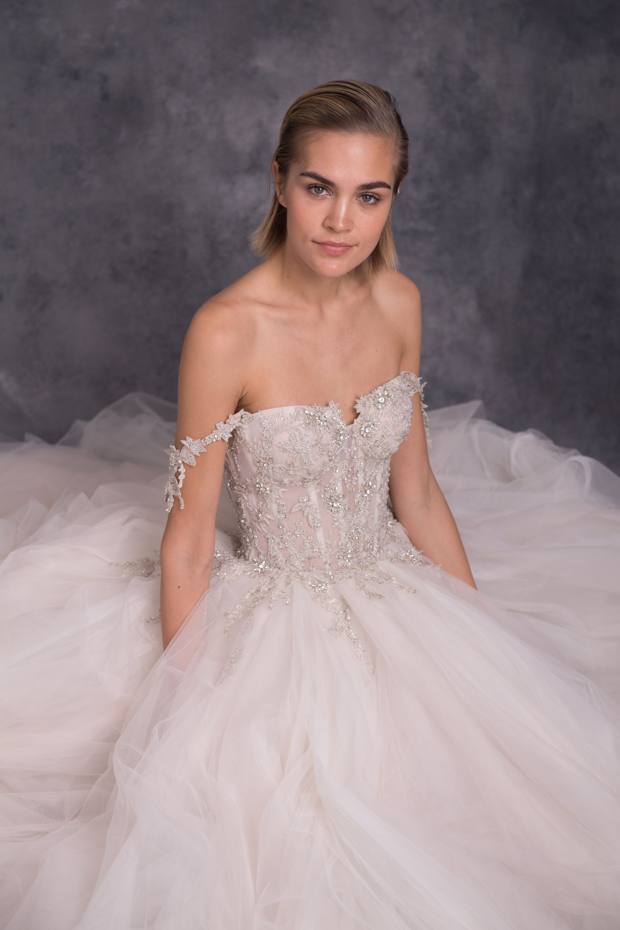 The mia is a dramatic princess ballgown with an elaborate beaded