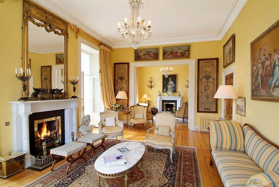 The marble fireplaces in this grand Irish manor bring warmth and traditional appeal to several rooms.