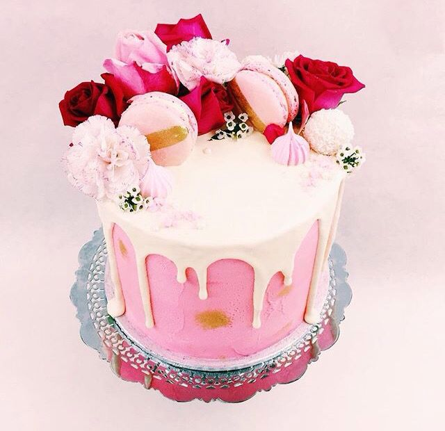Pink Cake With White Dripping Icing And Macaroons Cakes