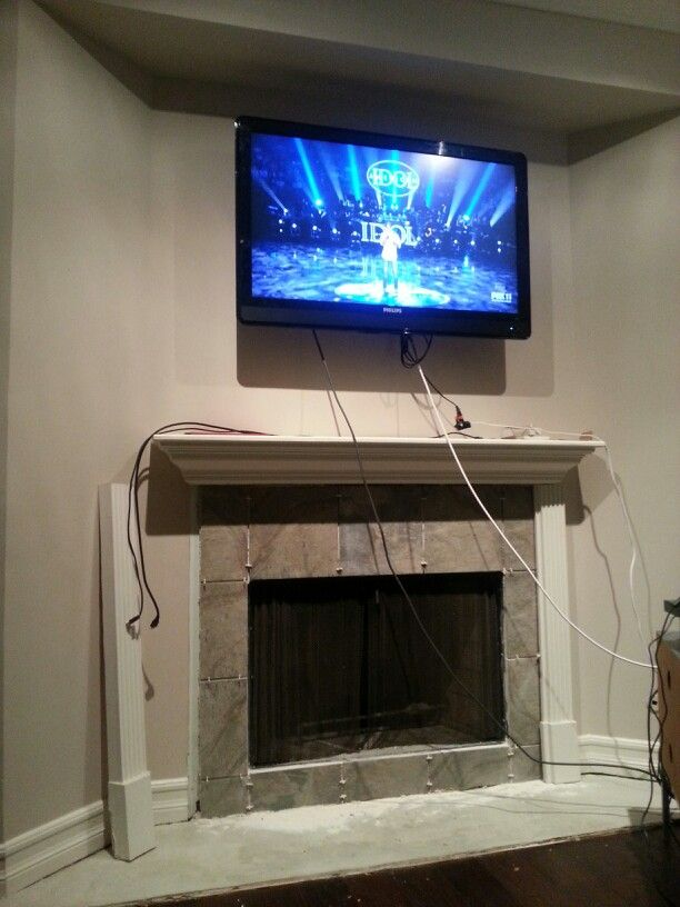 How to hide the electrical wires to the big screen tv located above ...