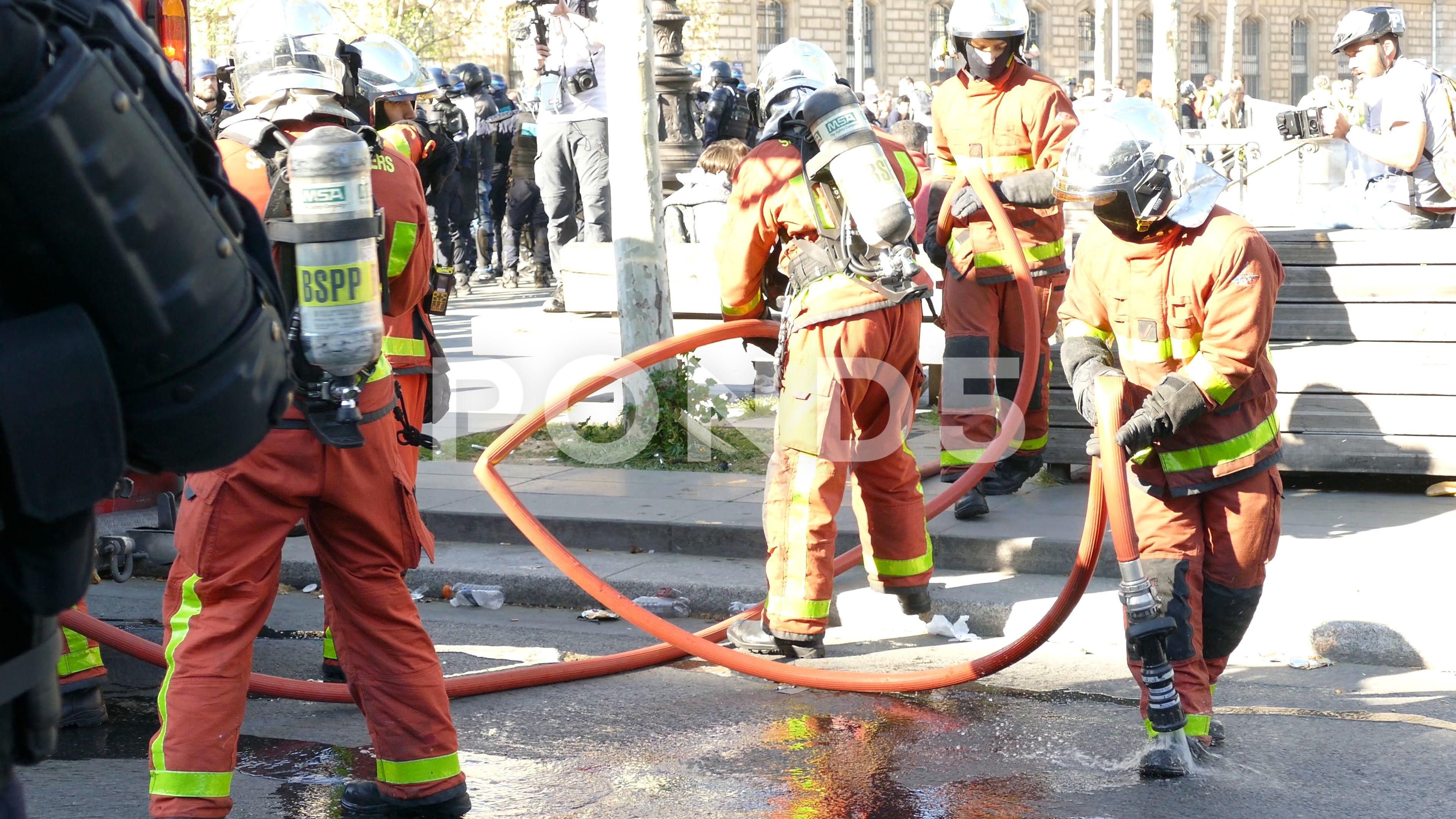 Scene Of Firefighters Extinguishing Fire At Place De La Republique