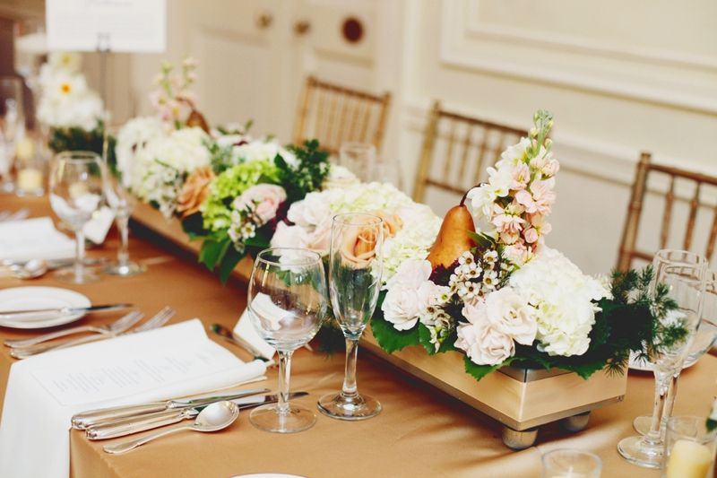 elegant blush, white, and gold centerpieces with pears like the