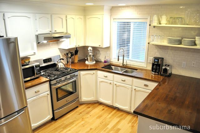 White cabinets subway tile walnut butcher block countertops