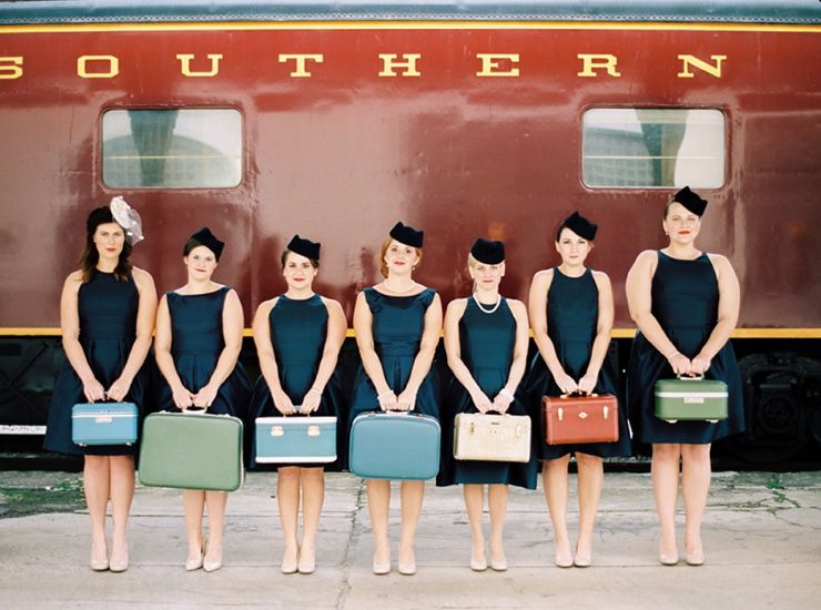 The bridesmaids were dressed like vintage flight attendants and carried vintage suitcases | fabmood.com