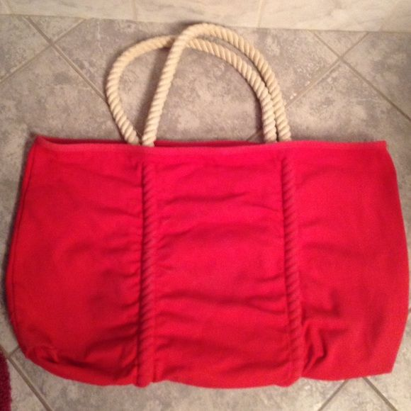 Large hot pink tote bag Perfect for the beach. Has white rope handles and an inside pocket for keys, a cell phone, or other small items. Was given as a gift. Bags Totes