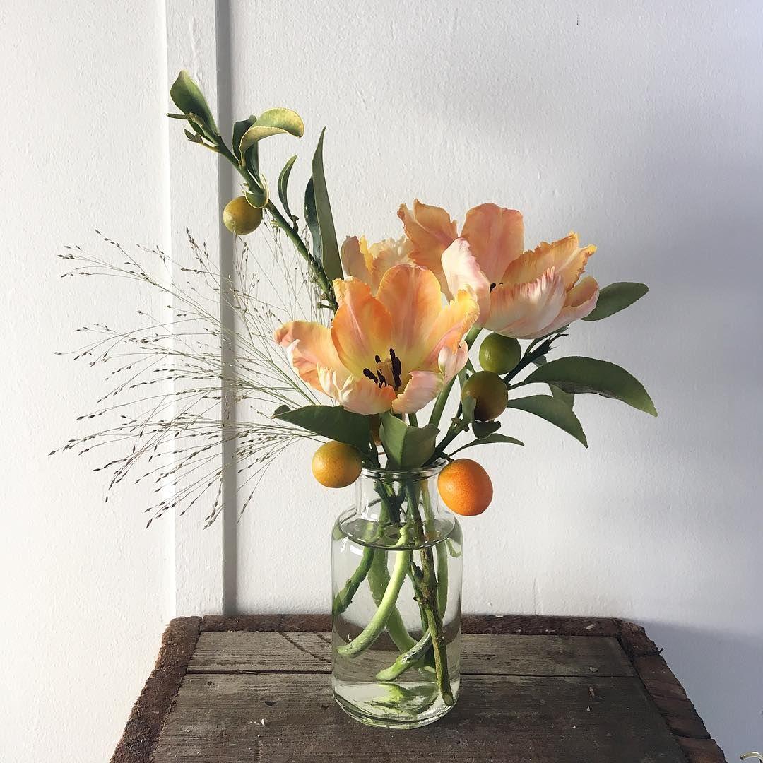 Bud Vase With Orange Parrot Tulips Explosion Grass And Kumquats Arrangement By Hello Flo Bud Vases Arrangements Tulips Arrangement Flower Vase Arrangements