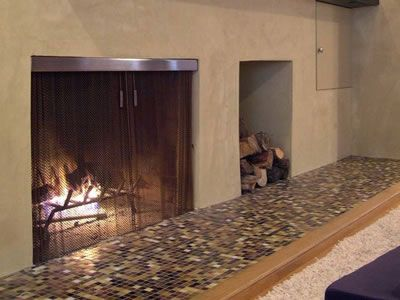 Metal Coil Drapery As Fireplace Mesh Curtain And Some Woods Are