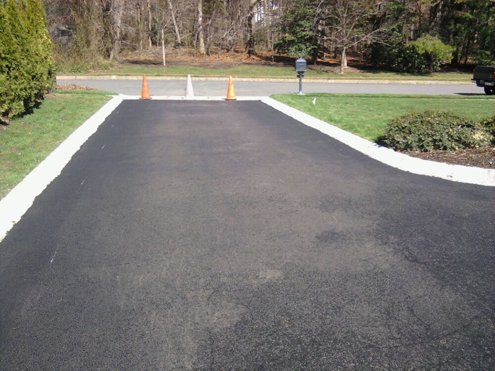 Paving an asphalt driveway all about the house great ideas paving an asphalt driveway all about the house solutioingenieria Images